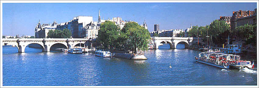 Postcard showing a panoramic view of the River Seine in Paris with the western tip of Ile de la Cité in the center, and the beginning of Hôtel de la Monnaie (on Quai de Conti) on the far right, behind the barges. The bridge is Pont Neuf (New Bridge).